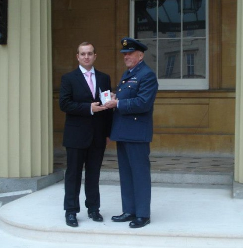 Sqn Ldr Woolcock collecting MBE with son.